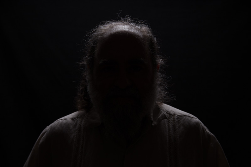 The hair and shoulder light by itself on a black background