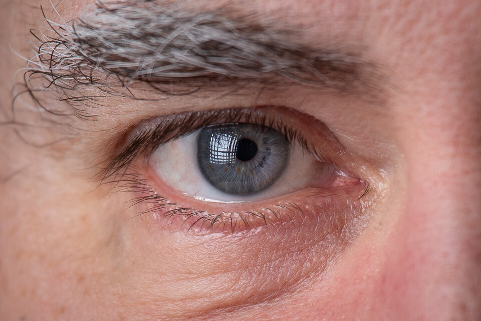 The grid on the softbox is seen in the catchlight in the eye.