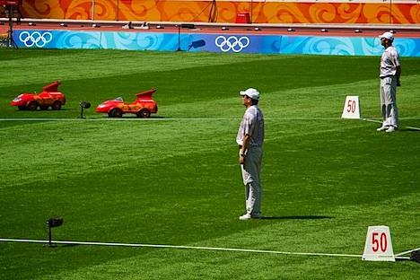 Red RC cars wait for a discus to return