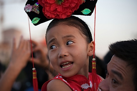 Girl watching flag lowering ceremony
