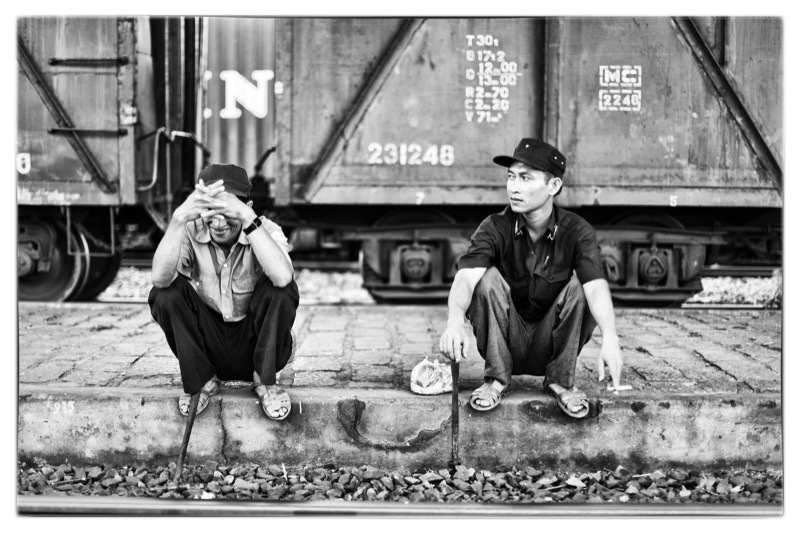 Train workers on break in Mương Mán, Vietnam