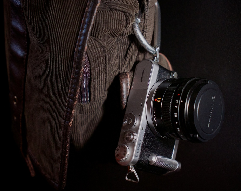 The LUMIX GM1, SUMMILUX 15mm ƒ/1.7, and Panasonic grip, hanging off my shoulder bag