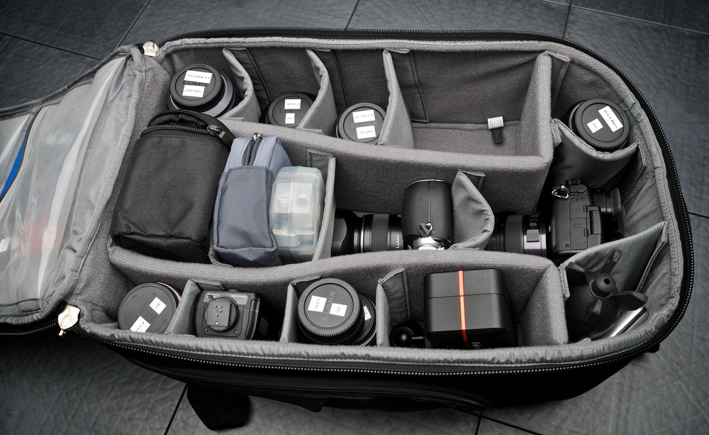 The ThinkTank StreetWalker HardDrive can hold a lot of gear, but as you can see in the photo the GH4 and GX7 cameras are much more shallow than the bag itself. Most lenses have too much bounce room, and most of the lenses that reach the top are actually multiple lenses, stacked on top of each-other!
