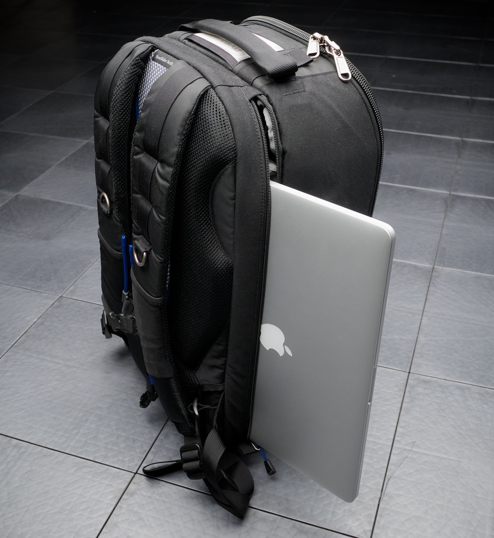 "The rear laptop compartment will accommodate a 15"" laptop. This is a MacBook Pro retina, which is exceptionally thin, so the depth fits easily. It is a bit of a squeeze though vertically to get it in; I always feel like I'm scraping the bottom edge of the Mac on the zipper."