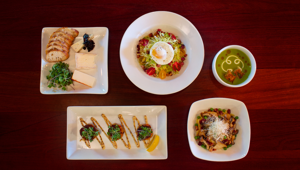 A top-down view of some of Liquid Assets' most popular dishes, shot as the hero photo for the website