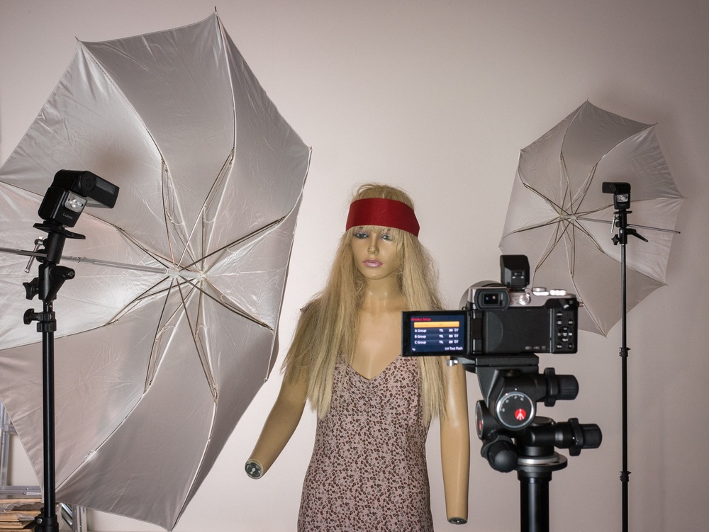Betty the mannequin, a LUMIX GX8 with the LX100's tiny included flash, and two LUMIX 580 strobes shooting through umbrellas