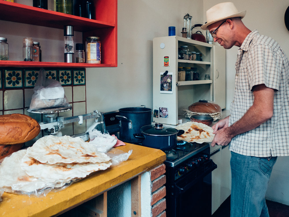 Our man Eric in his home outside of Oaxaca, heating up a bit of lunch for this weary traveler.