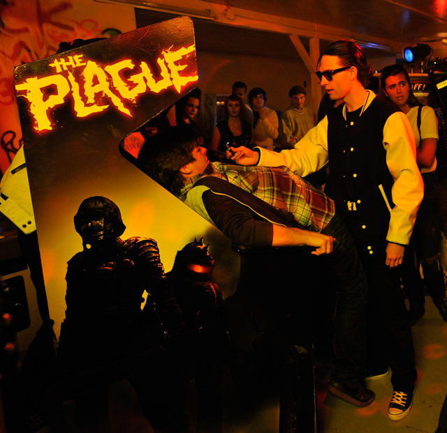 designed-the-logo-for-characters-the-plague-appearing-in-hobo-with-a-shotgun-the-logo-appears-in-the-film-on-an-arcade-machine-seen-above-2.jpg