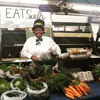 Farmers Market volunteer Kim Cole keeps the market lively.