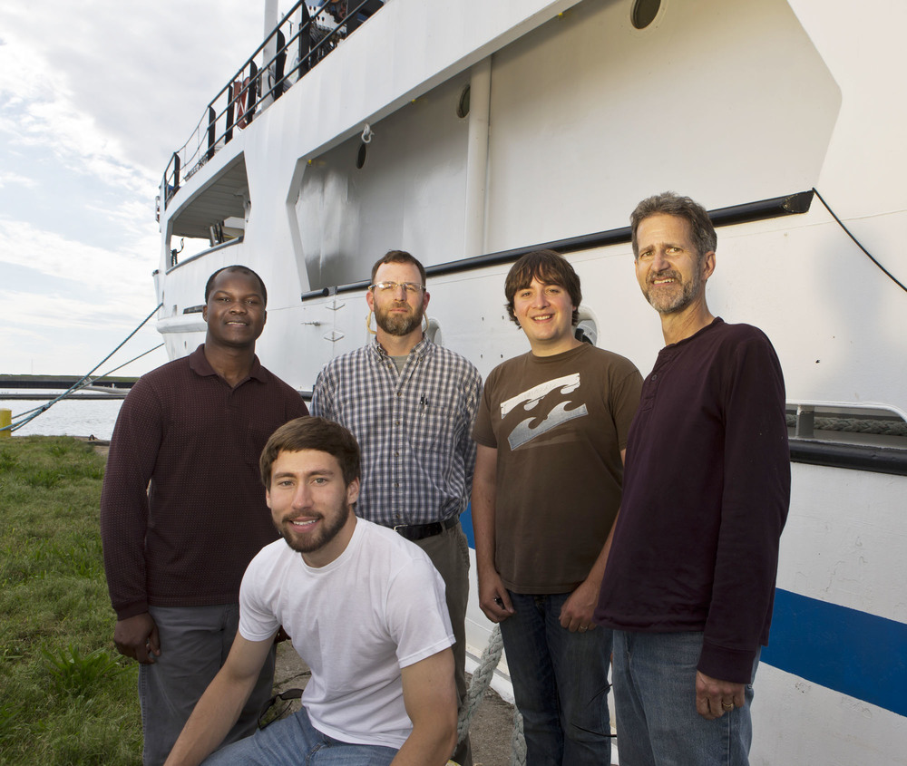 Pictured (left to right): Students Mark Omara and Adam Point, Prof. Bernie Crimmins, student Timothy Johnson and Prof. Tom Holsen during a four-day research journey exploring Lake Ontario aboard the EPA research vessel Lake Guardian