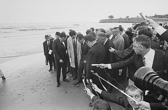 President Richard Nixon visits the site of the 1969 Santa Barbara oil spill with a cadre of print and broadcast reporters.