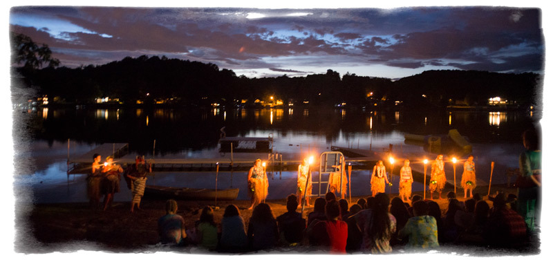 Color Wars Opening Ceremony at night on the lake.