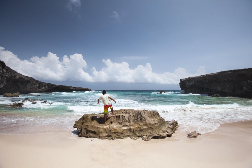 Beautiful Boca Prins beach hidden behind the rocks