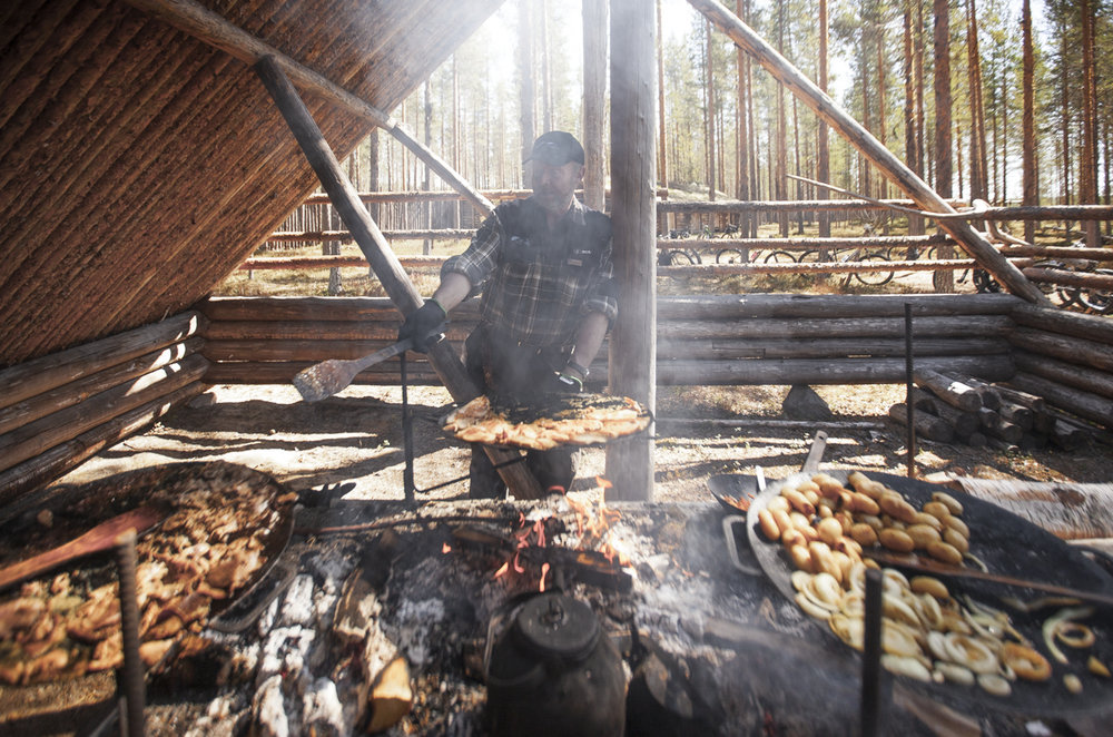 The open fire with locally produced meat and vegetables