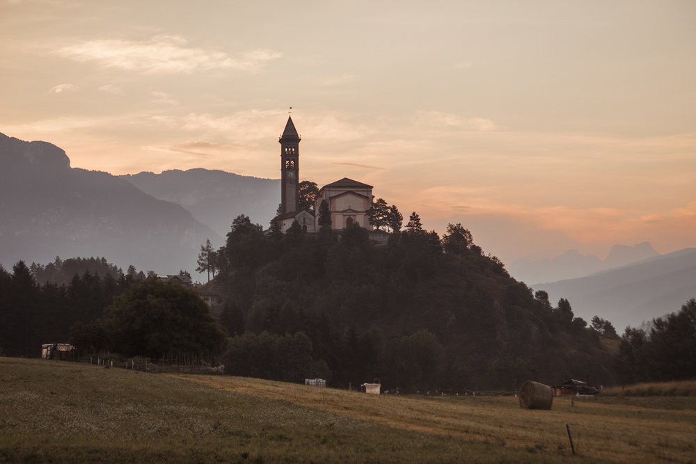 The Church of San Giorgio, located on a hill that dominates the town of Castello-Molina di Fiemme.