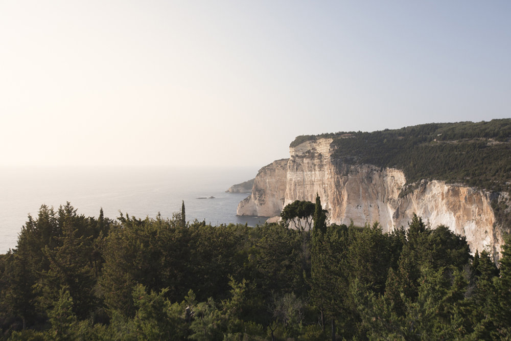 Here you will find a great place to watch the sunset reflecting on the cliffs of Erimitis