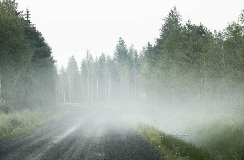 The Swedish back roads wind on into the wilderness. Inviting and mysterious, especially in the early evening light.