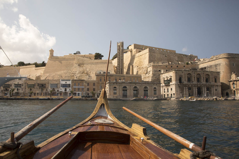 View on Valletta from a dgħajsa, which is a traditional water taxi from Malta