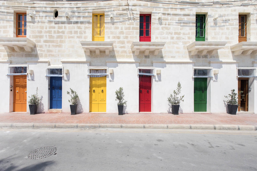 Doors painted in the famous colours of Marsaxlokk
