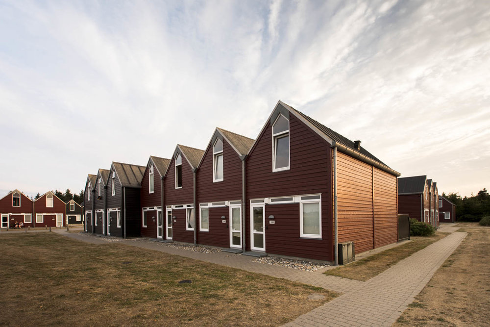 The comfortable red houses at the park are built in a traditional, simplistic Scandinavian style.