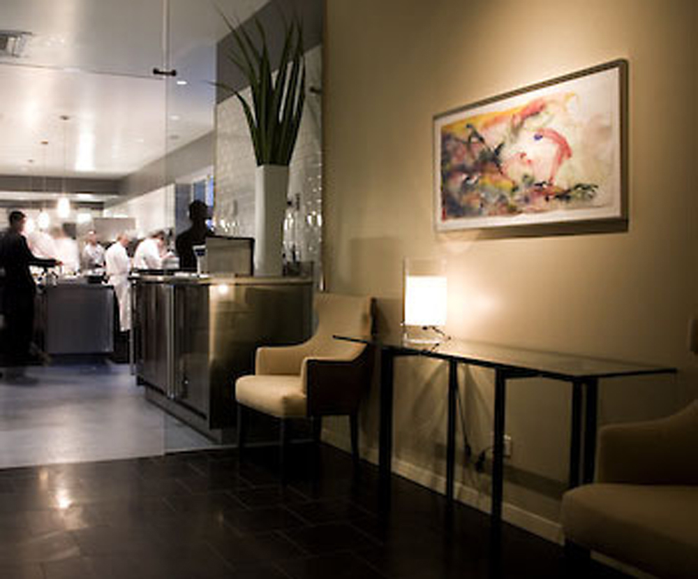 Between the kitchen and the dining room of Chicago's famed Alinea