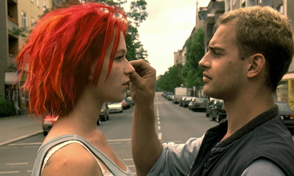 run lola Lola receives a phone call from her boyfriend manni he lost 100,000 dm in a subway train that belongs to a very bad guy lola has 20 min to raise thi.