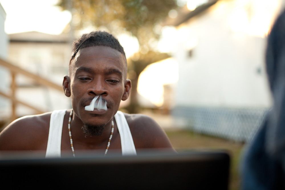 african american male smoke smoking confident computer