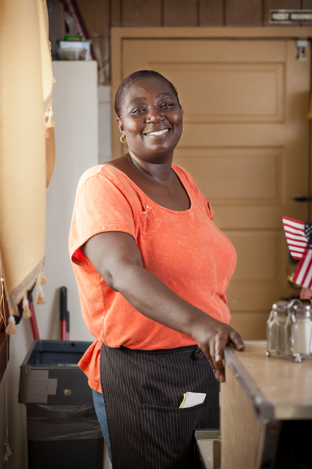 african american female restaurant server portrait