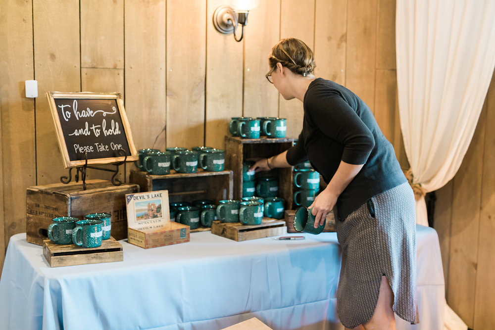 Whitney from Rustic Manor getting all set up! Those camp mugs were such a fun favor for the guests.