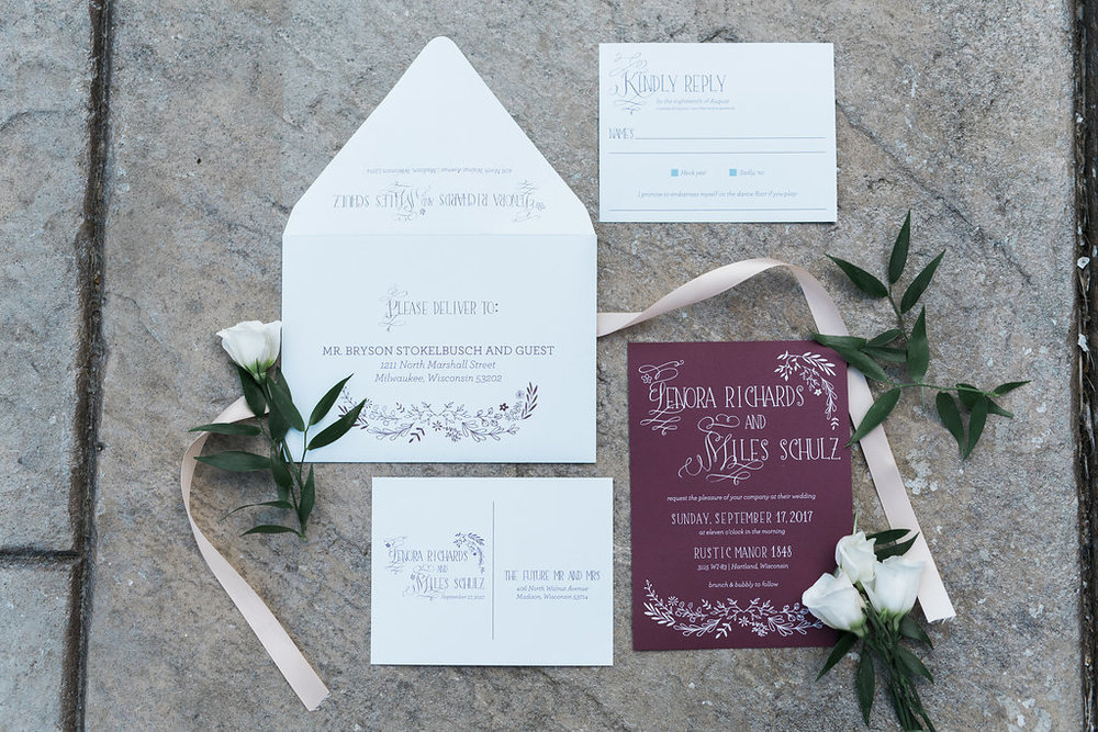 Each guest received these dusty blue and burgundy invitations. We love the simplicity!