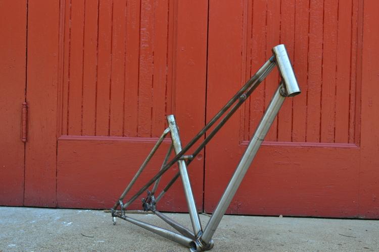 raw steel against red door.jpg