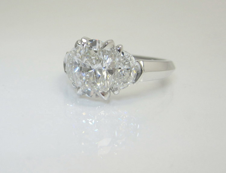 Beautiful Oval & Half-Moon Three-Stone Diamond Ring — Booth Custom Jewelers KS83