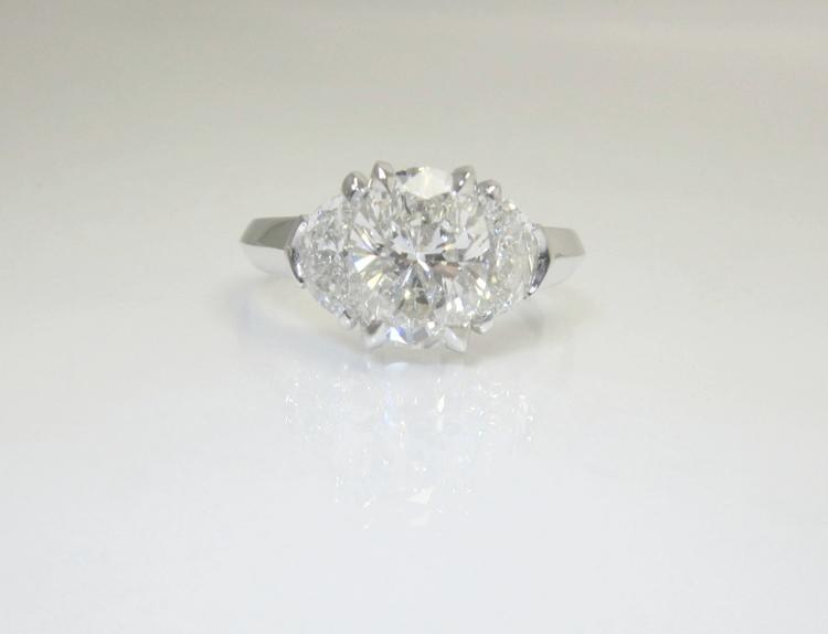 Fabulous Oval & Half-Moon Three-Stone Diamond Ring — Booth Custom Jewelers DY16