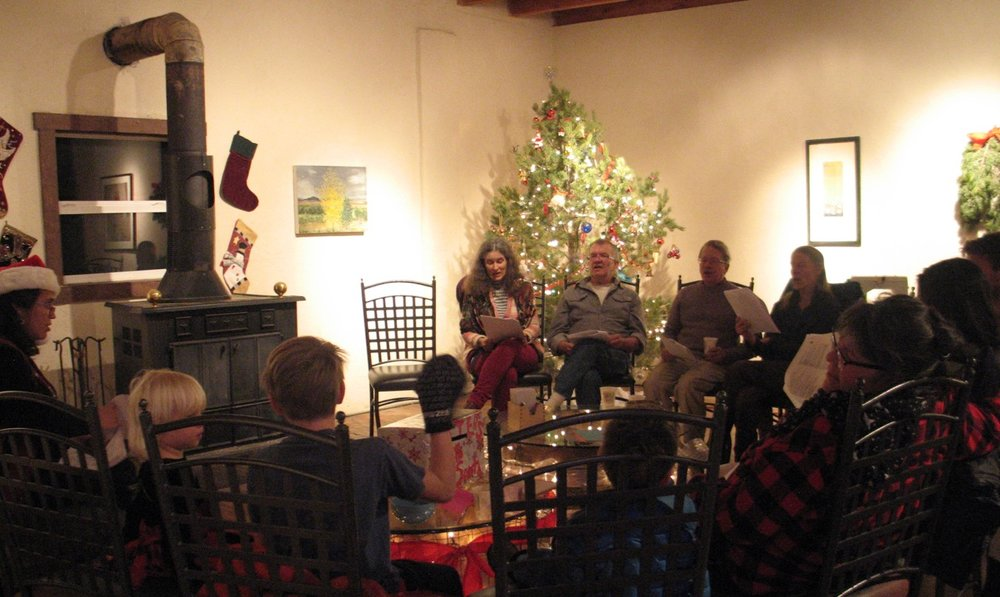 Caroling around the fire at last year's holiday open house