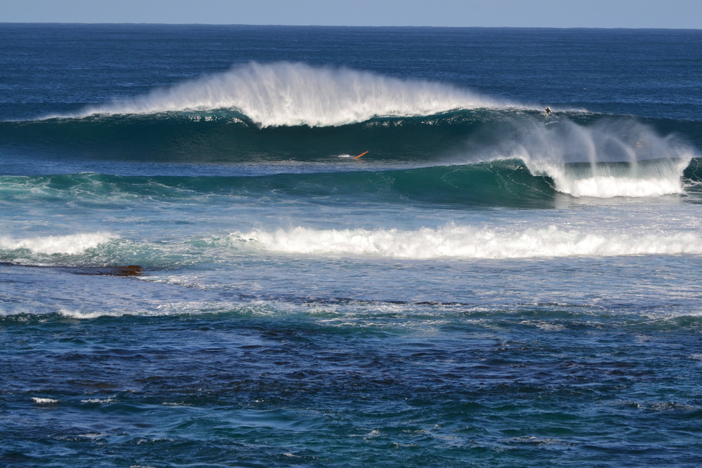 TOM WAS GEEING HIMSELF UP TO PADDLE OUT FOR A CRACK AT MARGARET RIVER MAIN BREAK (THERE WERE ONLY SIX GUYS OUT) WHEN WE SAW THIS SET COME THROUGH . . .