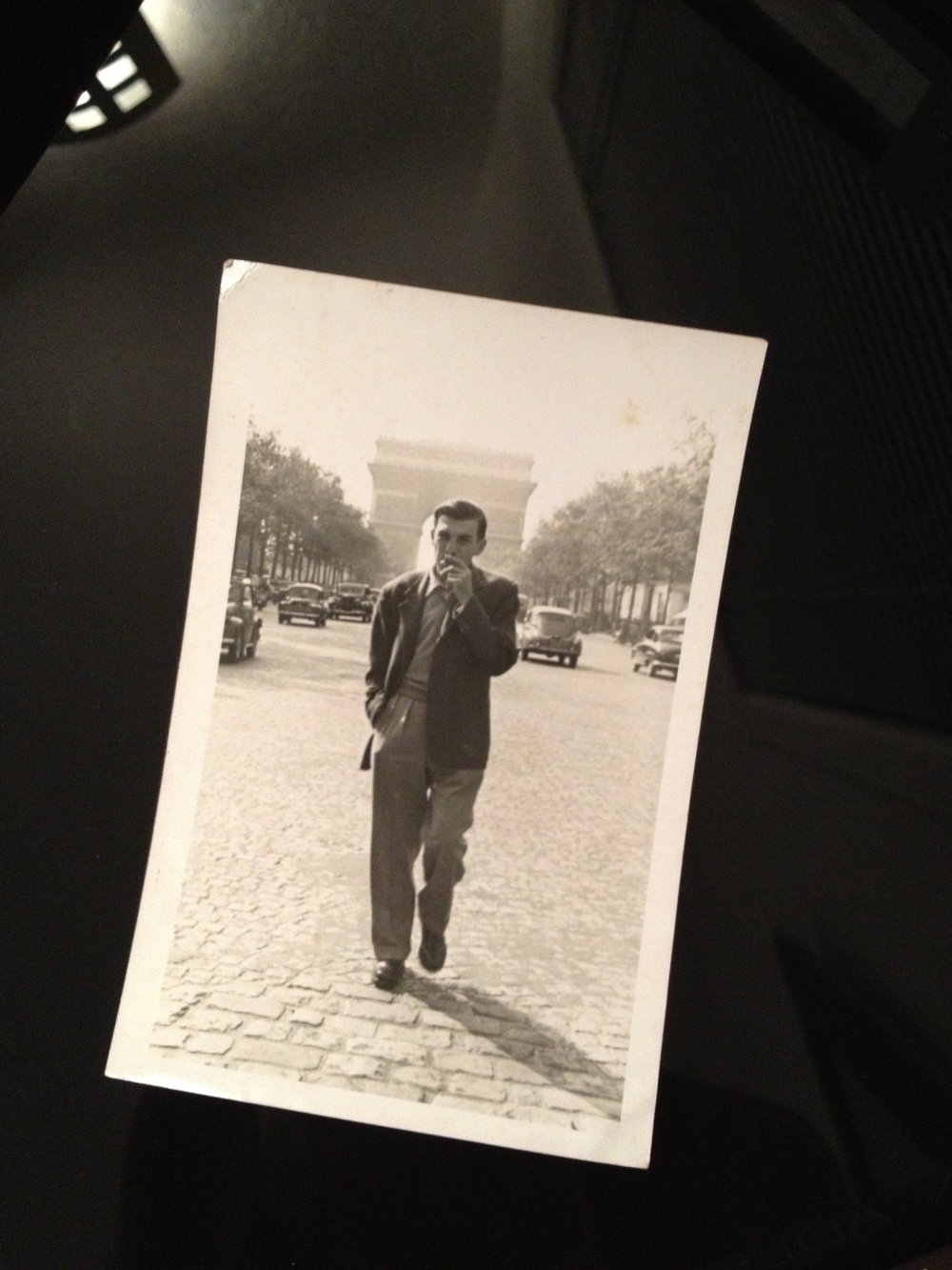 "The original photo, smaller than a 4"" X 6,"" of my grandfather in Paris, dated May 4, 1953."