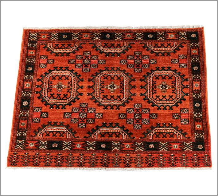 This is on the traditional side, but bold nonetheless. Afghan rug, Pottery Barn.