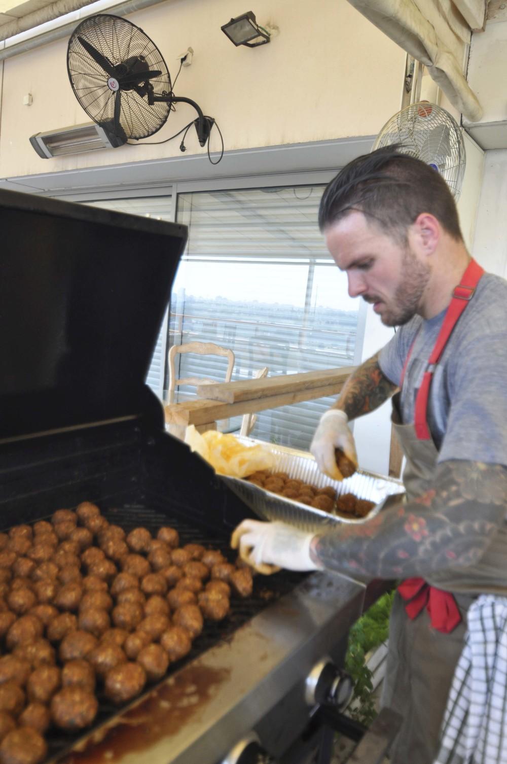 Nate Appleman Grilling Meatballs in Tel Aviv, Israel