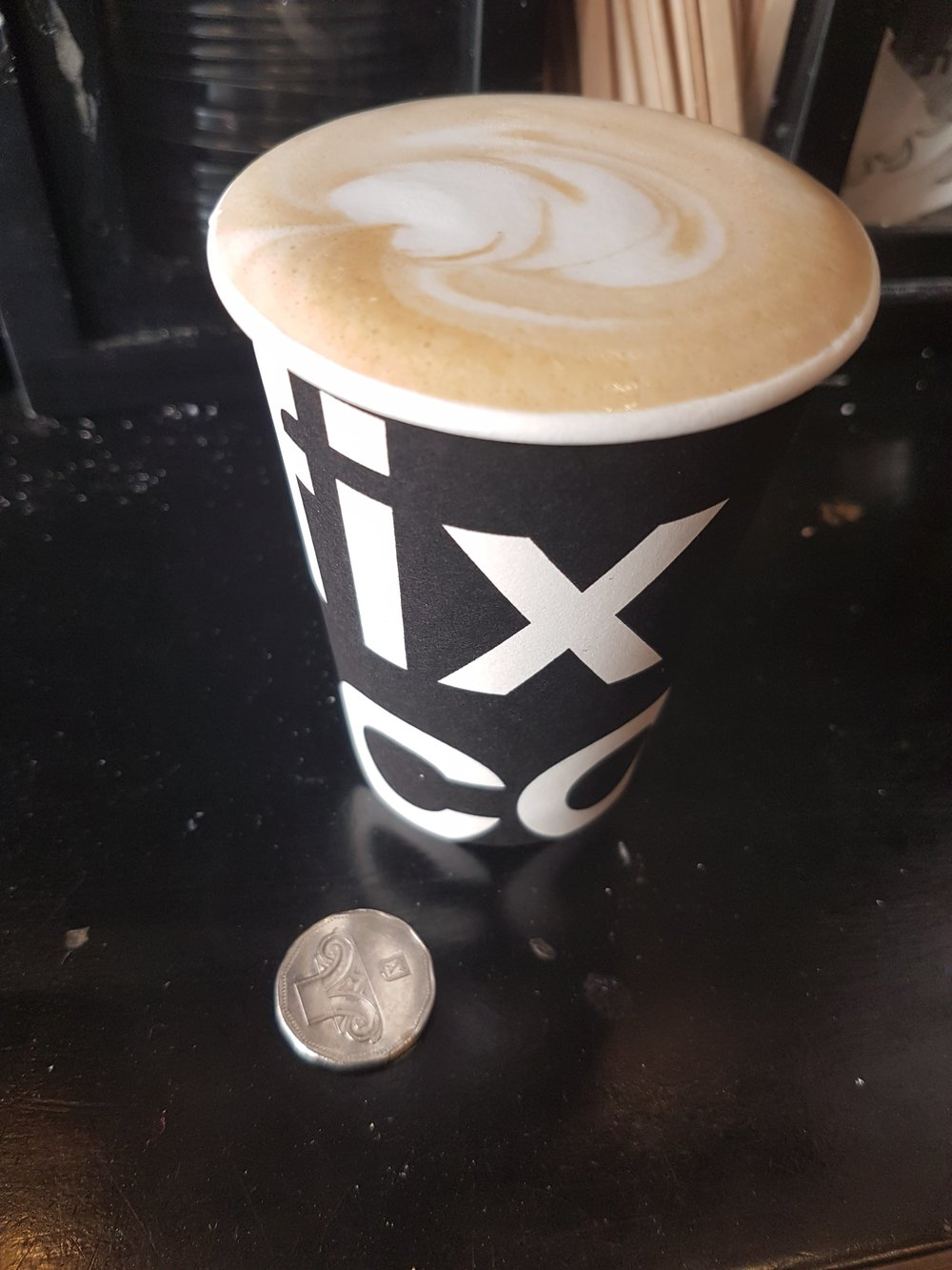 Cofix Latte with 5 shekel coin. Back to the Future
