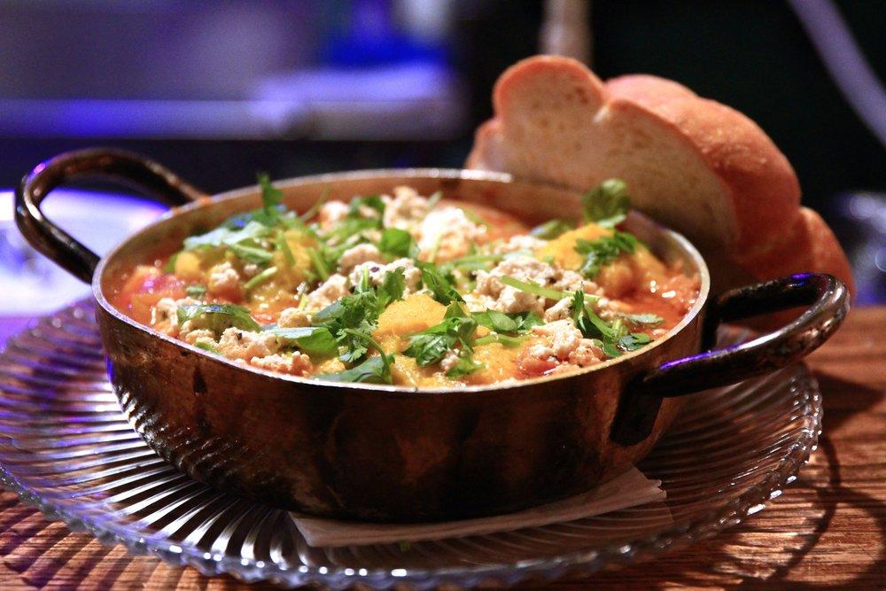 Zakaim's innovative take on shakshuka, with lima beans and turmeric instead of poached eggs. Photo: Zakaim