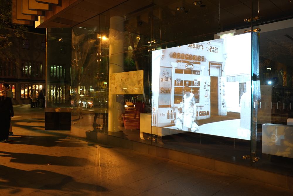 Projection outside the Surry Hills Library on Crown St featuring scenes of the street from the 1960s, as captured by Italian film maker Gian Carlo Manara for the ABC documentary 'Living on the Fringe'.