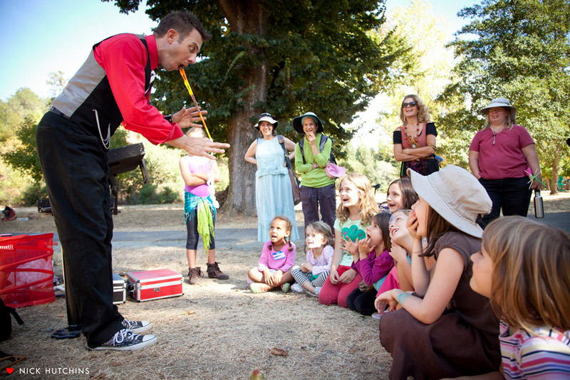 Performing magic for children at Art in Nature Festival.