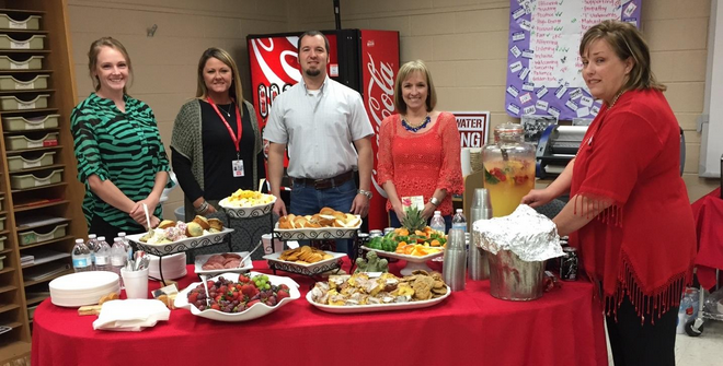 SHS History Teacher Amy Clark, Assistant Principal Tecka Mobley, Trinity Baptist Church Pastor Matt McGowan, Trinity Baptist Church Education Minister Gretchen Jones, and SHS Counselor Kellie Kiker enjoy fellowship during student testing.