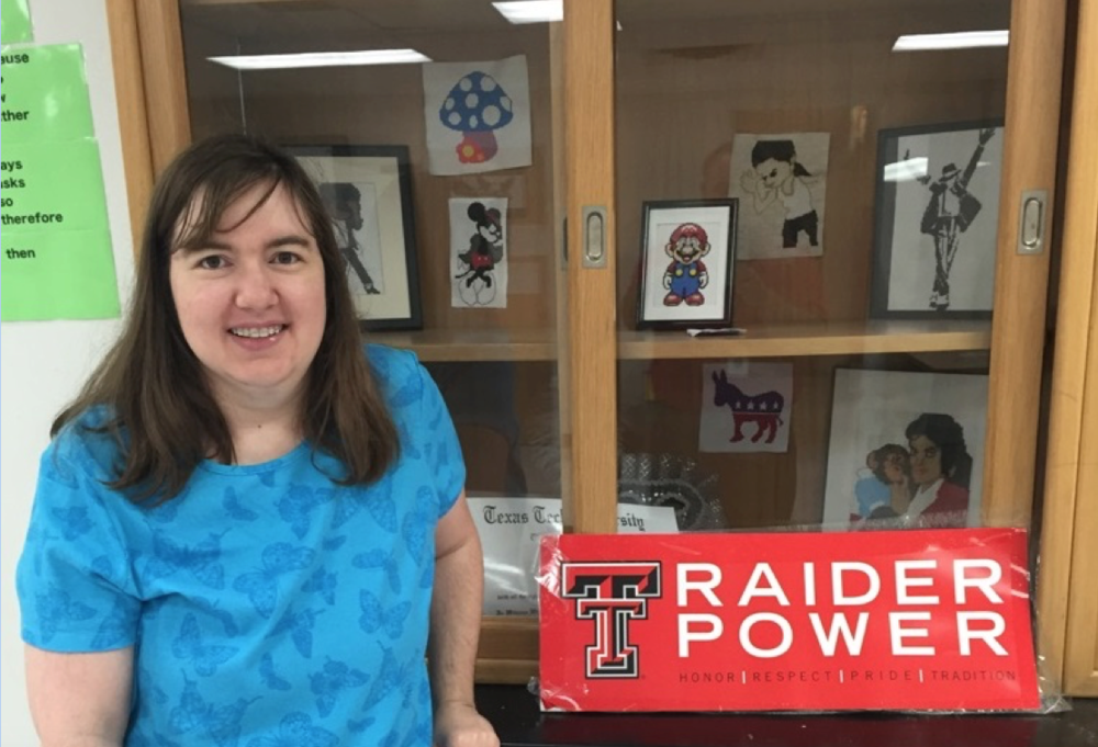 Ms. Vickers, standing by a display in her SHS Dual Credit and Spanish Classroom, proudly displays Texas Tech University pride.