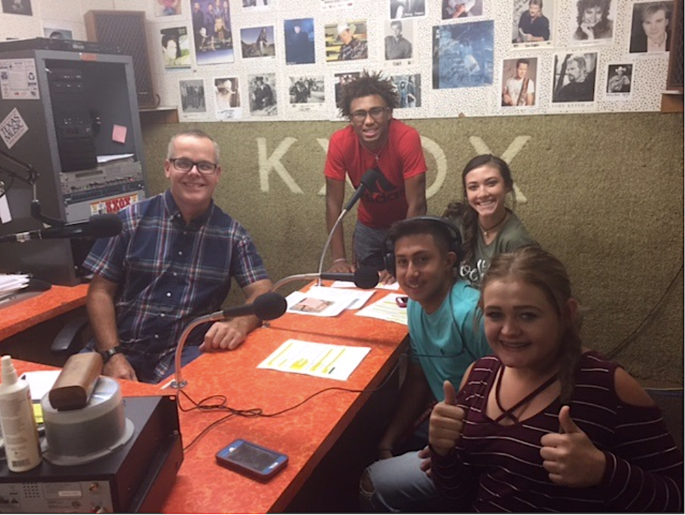 Sweetwater High School Seniors Kobe Clark, Jaelynn Page, Tristan Longoria, and Journee Pugh work with KXOX Broadcaster Richard Ferguson to record two SHS commercials that will air during varsity football and volleyball games.