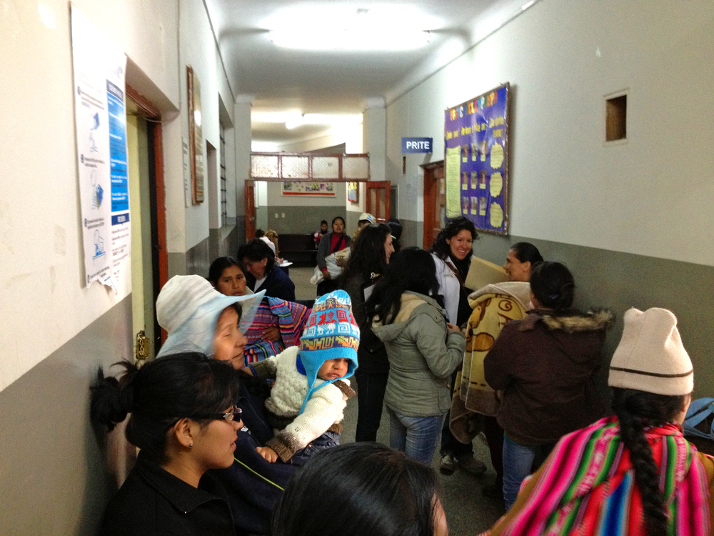 "Moms and other patients will often arrive very early in the morning, sometimes before 7 AM, and will wait for hours, standing in hallways like these at Belenpampa in Cusco, to see a doctor or nuses. This clinic does not function on a ""first come, first serve"" schedule. Photo taken: June 1, 2013."