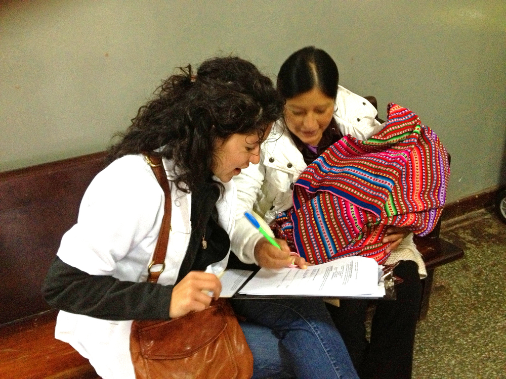 Sometimes the moms prefer to fill out the answer choices on the data questionnaires themselves, as this mom does with Vanessa! Photo taken: June 1, 2013.