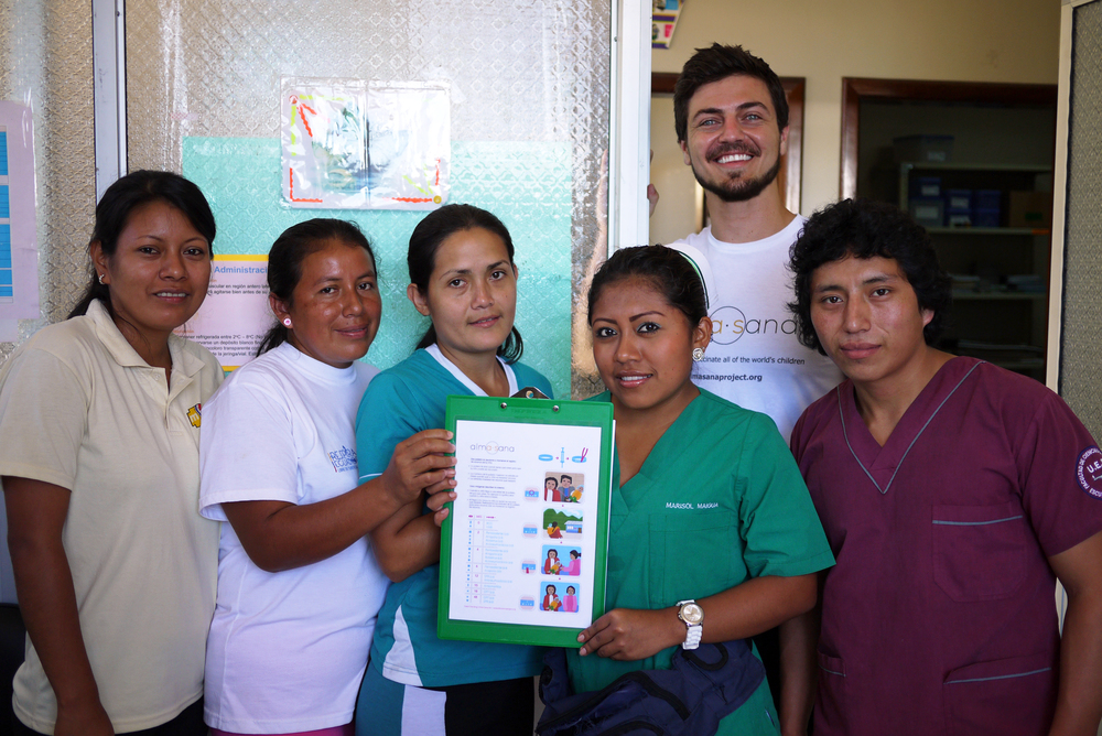 After a day of training at one of the clinics, Alex Bozzette, our Ecuador Project Coordinator, stands with a team of nurses. They are displaying the bracelet vaccination guide. Photo taken: June 25, 2013.