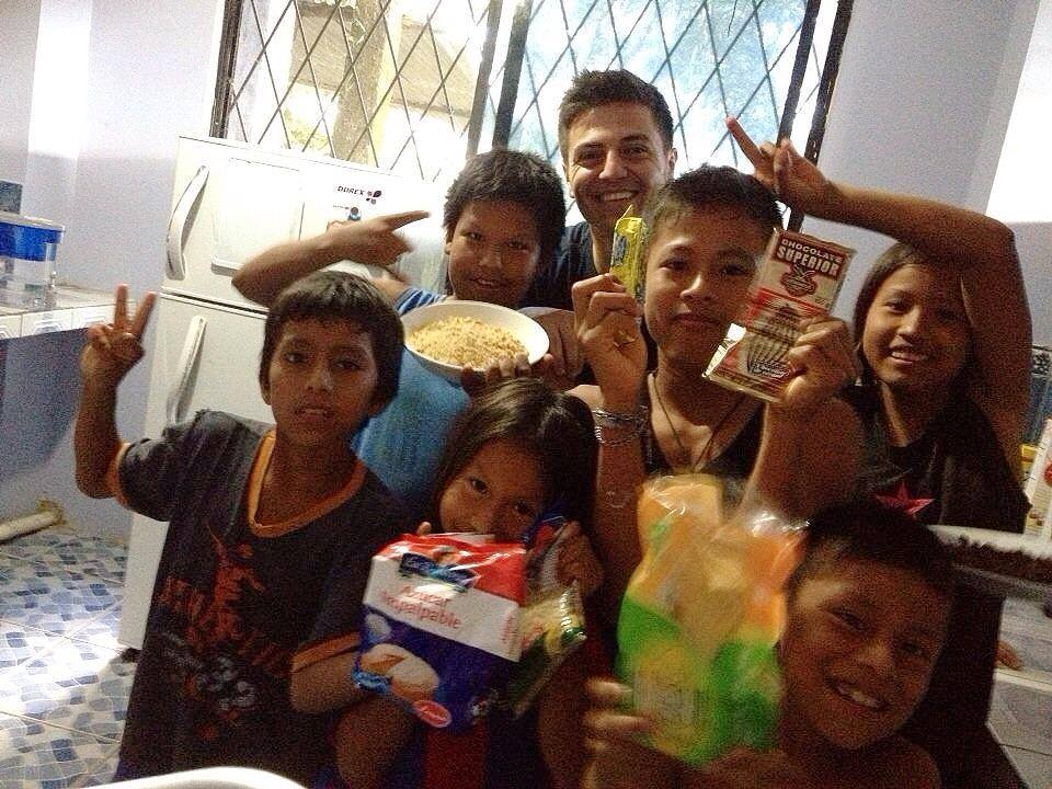Happy Holidays from Alma Sana! Here's Alex Bozzette, our Ecuador Project Coordinator, taking a break from vaccine tracking to bake Christmas cookies with some pretty excited and helpful Tena locals. Photo posted: December 28, 2013