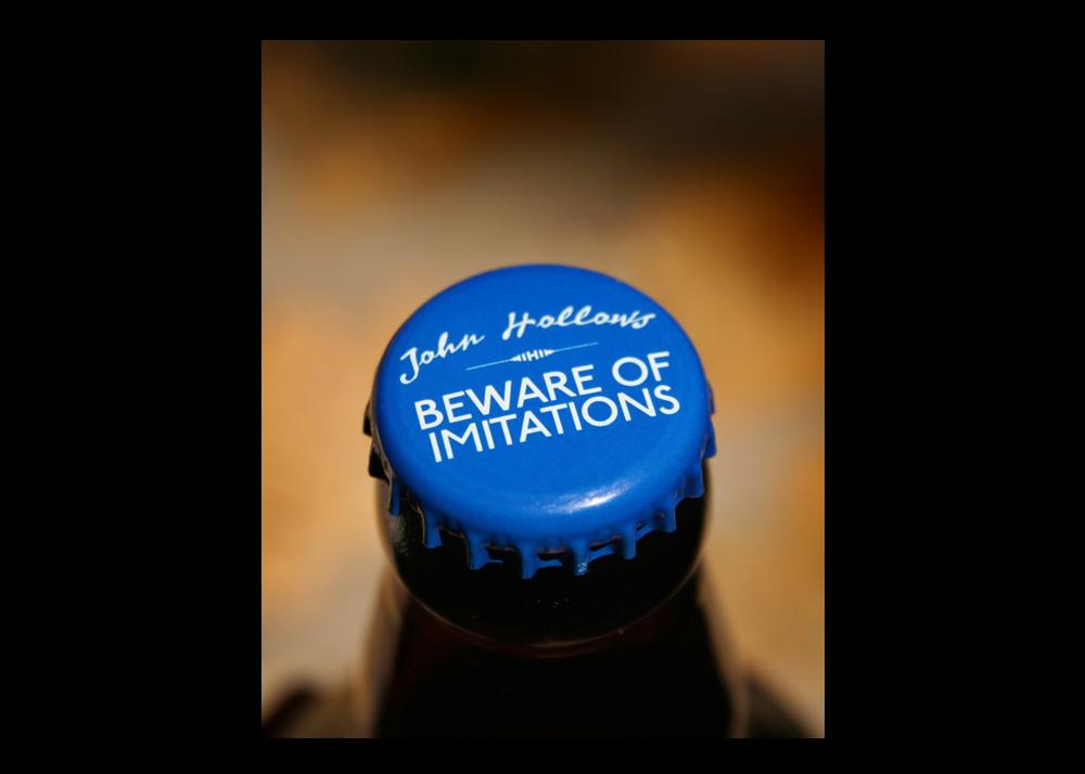 Hollows_BottleTop_BewareOfImitations.png